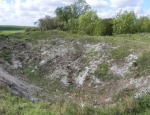 mine-crater-cleared-of-vegetation-september-2011