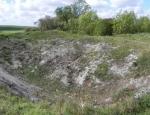 mine-crater-cleared-of-vegetation-september-2011