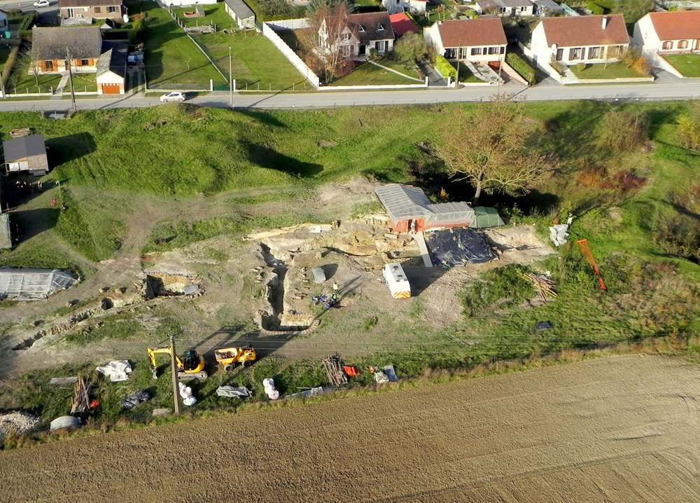 View of excavation site with protected area constructed over exhumation area