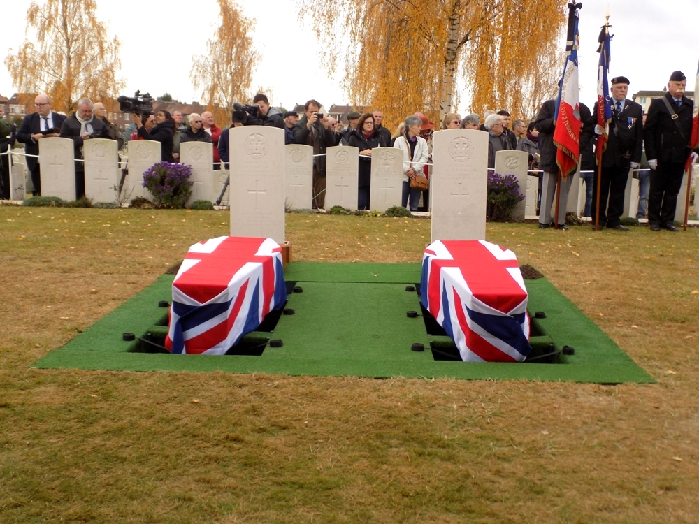 Flag draped coffins at the graves
